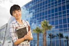 Mixed Race Female Student Holding Books in Front of Building Royalty Free Stock Image