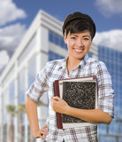 Mixed Race Female Student Holding Books in Front of Building Stock Photos