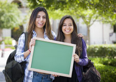 Mixed Race Female Students Holding Blank Chalkboard Stock Images