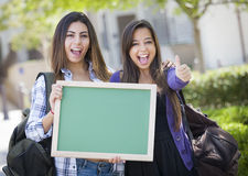 Mixed Race Female Students with Thumbs Up Holding  Stock Images