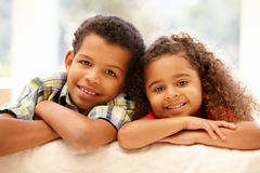 Mixed race girl and boy at home stock images