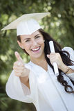 Mixed Race Girl In Cap and Gown with Diploma Stock Image