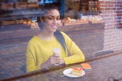 Mixed race girl with coffee view through the window Royalty Free Stock Image