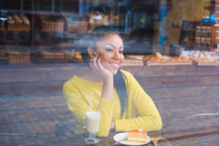 Mixed race girl with coffee view through the window Stock Photography