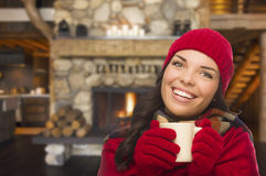 Mixed Race Girl Enjoying Warm Fireplace and Holding Mug Royalty Free Stock Photo