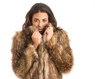 Mixed race girl in fur coat Royalty Free Stock Image
