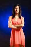 Mixed race girl in party dress on blue Royalty Free Stock Photos