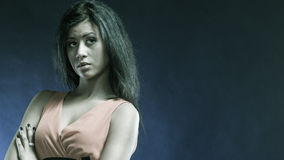 Mixed race girl portrait on blue Stock Photography