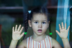 Mixed race girl at the window Stock Images