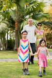 Mixed-race girls and parents in the park Royalty Free Stock Photography