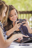 Mixed Race Girls Working on Electronic Devices Stock Images