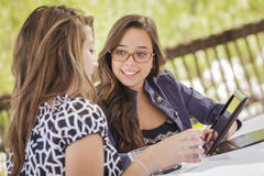 Mixed Race Girls Working on a Tablet Computer Royalty Free Stock Photo