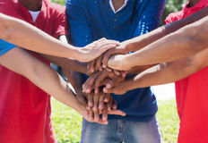Mixed race group putting hands together Royalty Free Stock Photography