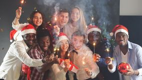 Mixed race group of young people at Christmas party. Slow motion. stock footage