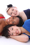 Mixed race happy girls tower of smiling faces Stock Photography