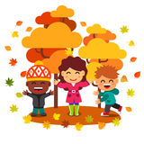 Mixed race kids having fun and playing with leaves Stock Photo