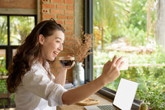 Mixed race lady take self photo while sip hot black coffee and u stock images