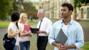 Mixed-race male student looking into distance, higher education and future. Stock photo stock image