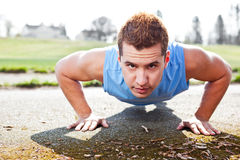 Mixed race man doing push up Stock Photography