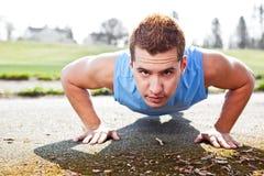 Mixed race man doing push up. A shot of a mixed race man doing push up outdoor Stock Photography