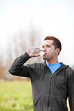 Mixed race man drinking water Stock Photo