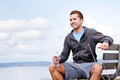 Mixed race man holding water bottle Royalty Free Stock Photography
