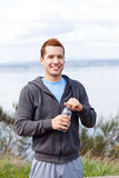 Mixed race man holding water bottle Stock Photography