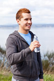 Mixed race man holding water bottle Royalty Free Stock Image