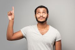 Mixed race man pointing up Royalty Free Stock Image