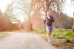 Mixed race man running. A shot of a mixed race man running outdoor Stock Images