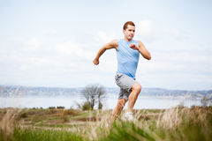 Mixed race man running stock photo