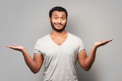 Mixed race man spreading his hands Royalty Free Stock Images