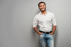 Mixed race man standing on grey background Stock Photo
