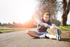 Mixed race man stretching Royalty Free Stock Image