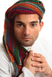 Mixed race middle eastern man. Mixed race middle eastern ethnic man wearing a robe and wovan turban keffiyeh Stock Images