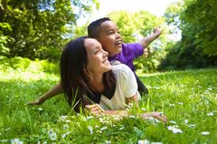 Mixed race mother and son smiling outdoors Stock Photos