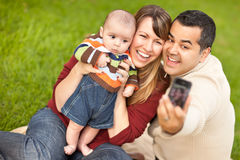 Mixed Race Parents and Baby Boy Taking Pictures Royalty Free Stock Images
