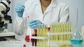 Mixed race research analyst working in laboratory, biochemical reaction. Stock footage stock footage