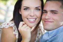 Mixed Race Romantic Couple Portrait in the Park Stock Photo