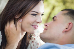 Mixed Race Romantic Couple Portrait in the Park Stock Photos