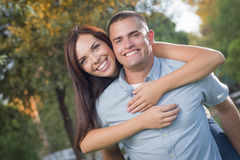 Mixed Race Romantic Couple Portrait in the Park Royalty Free Stock Photography