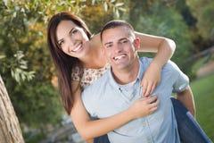 Mixed Race Romantic Couple Portrait in the Park Stock Photo
