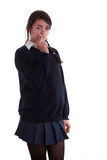 Mixed race schoolgirl smoking Royalty Free Stock Images