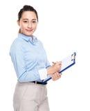 Mixed race secretary write on clipboard Royalty Free Stock Photo