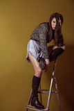 Mixed race sexy fashion model posing on stepladder. Stock Photo