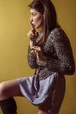 Mixed race sexy fashion model posing on stepladder. Stock Photo