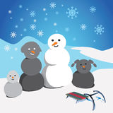 Mixed race snowman family. On winter scene Royalty Free Stock Images