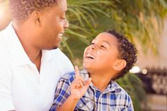 Mixed Race Son and African American Father Playing Outdoors. Together Royalty Free Stock Images