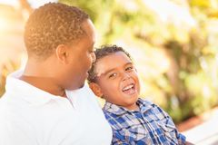 Mixed Race Son and African American Father Playing Outdoors. Together stock images