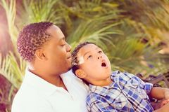Excited Mixed Race Son and African American Father Playing Outdoors Toge Royalty Free Stock Image
